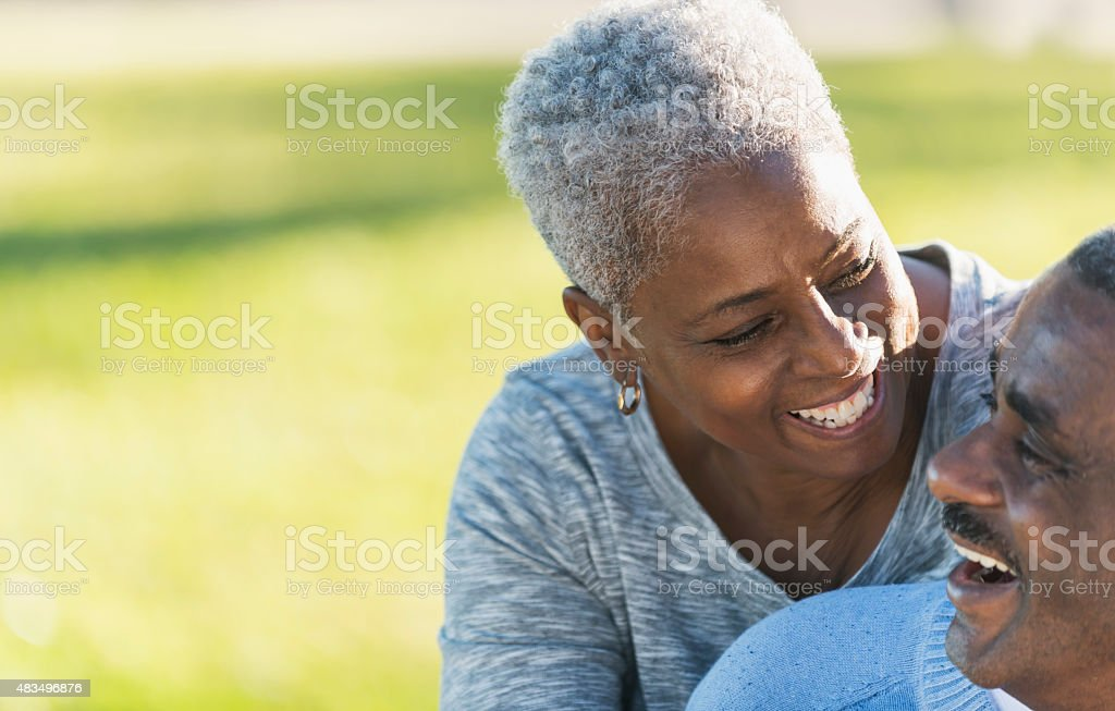Affectionate African American couple outdoors stock photo