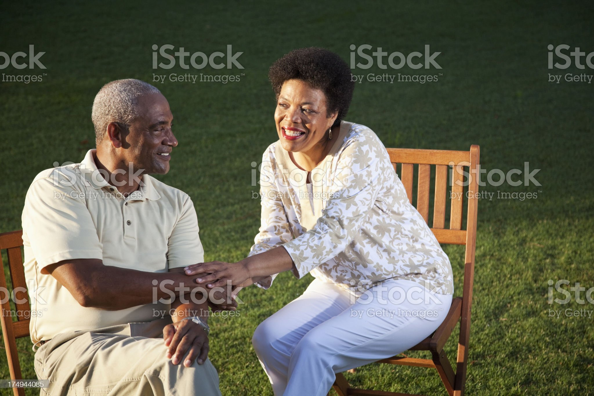 Affectionate African American couple sitting outdoors royalty-free stock photo