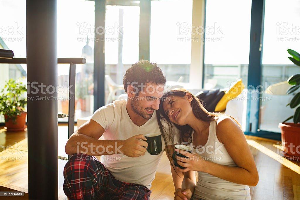 Affectionate couple enjoying  morning coffee and flirting stock photo