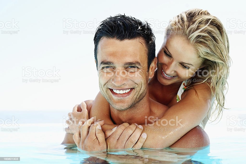 Affectionate couple hugging in pool royalty-free stock photo