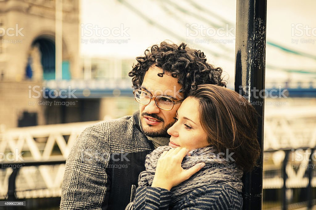 Affectionate couple hugging near the Tower Bridge stock photo