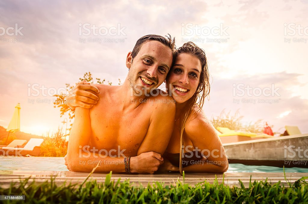 Affectionate couple in swimming pool royalty-free stock photo