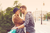 Affectionate couple in the city at sunset, outdoor portrait