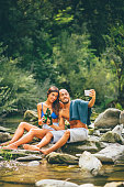 affectionate couple taking selfie on the river