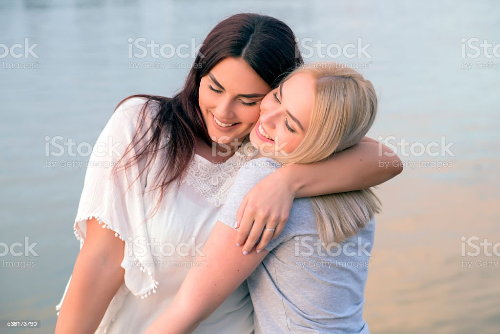 Affectionate friends embracing each other, Women hugs stock photo
