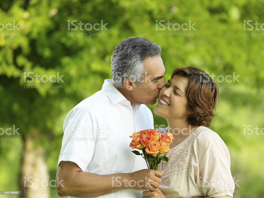 Affectionate husband giving flowers royalty-free stock photo