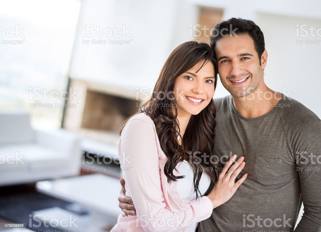 Affectionate Latin couple at home stock photo