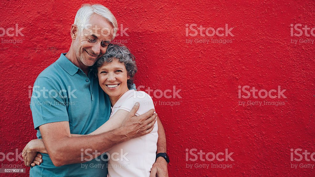 Affectionate mature couple embracing each other stock photo