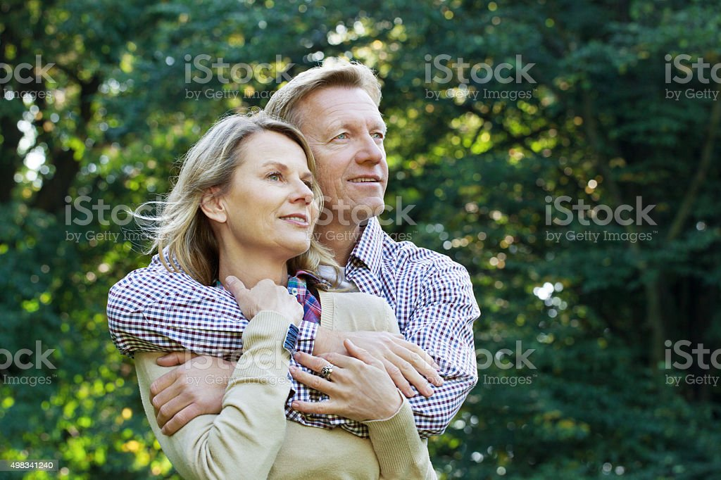 Affectionate mature couple outside in a park stock photo