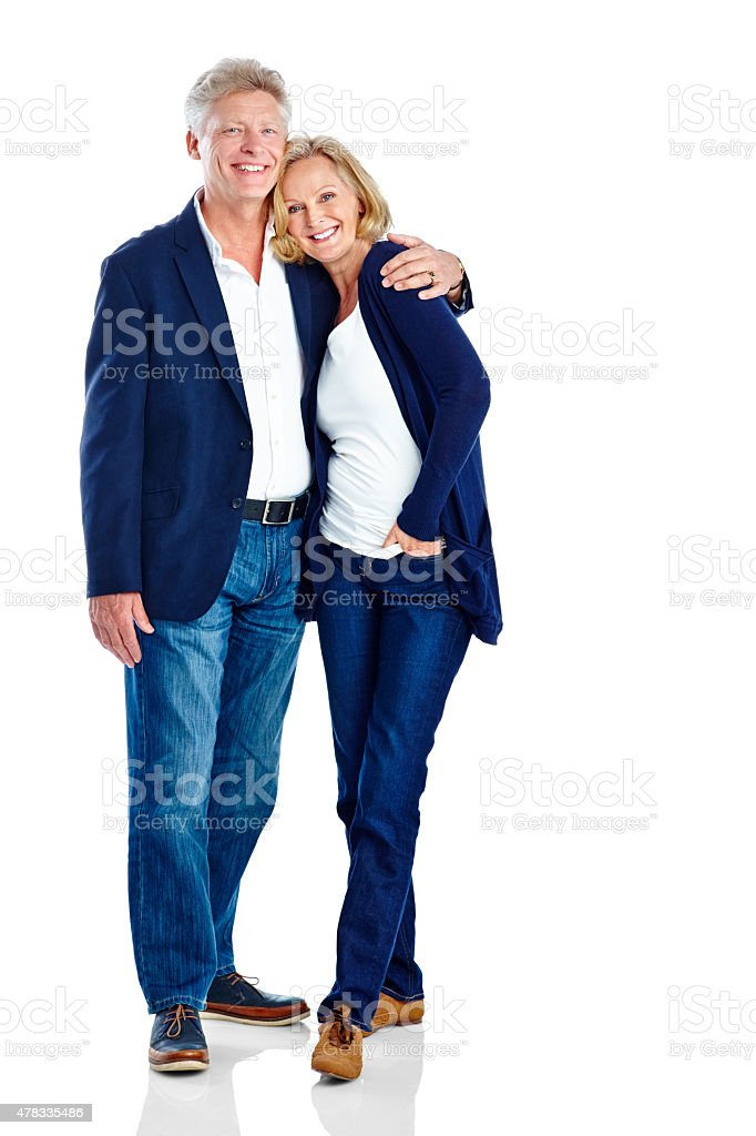 Affectionate mature couple standing relaxed stock photo