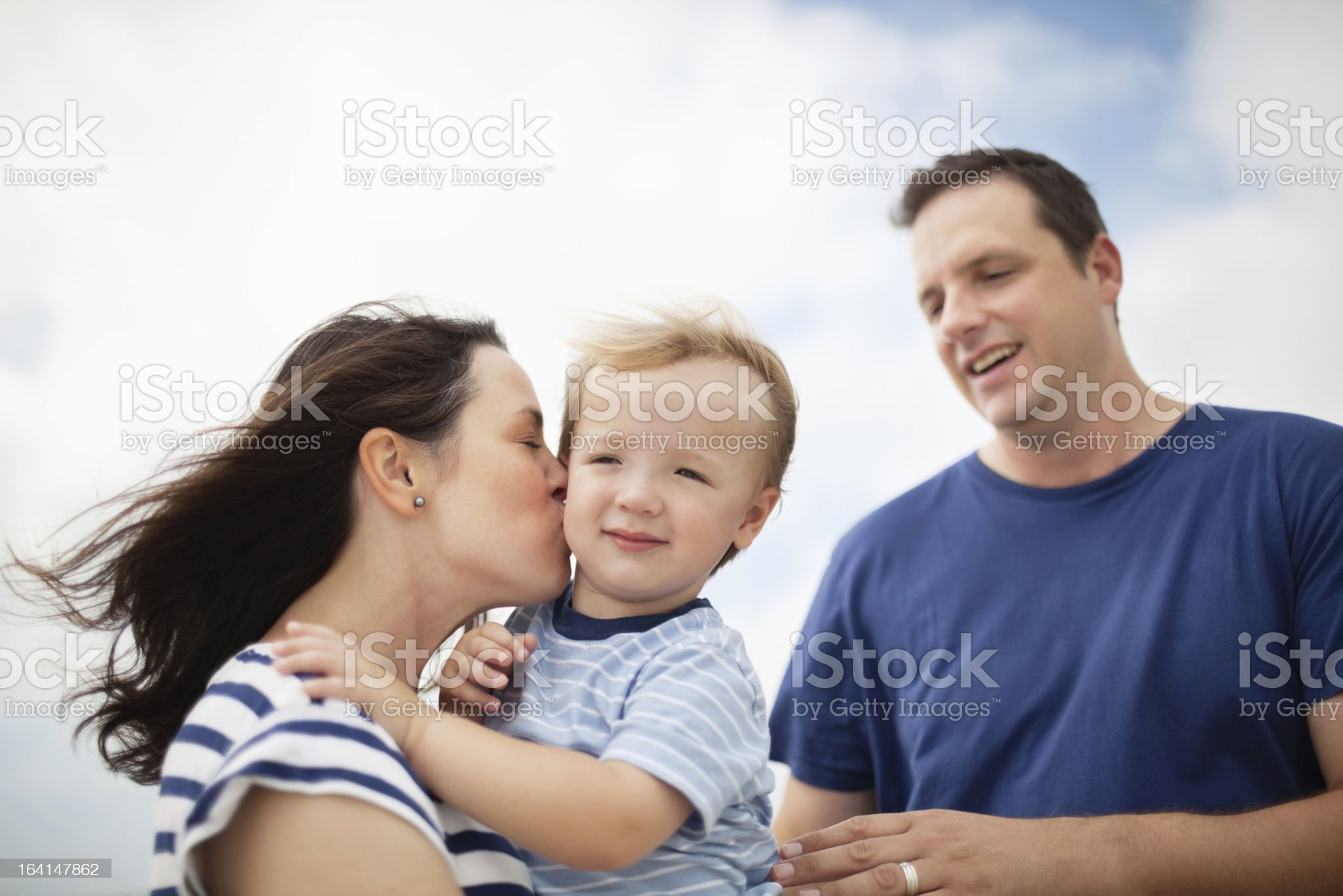 Affectionate Parents With Son Outdoors royalty-free stock photo