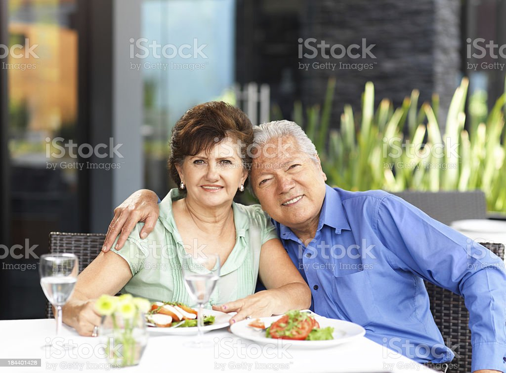 Affectionate senior couple in a restaurant royalty-free stock photo