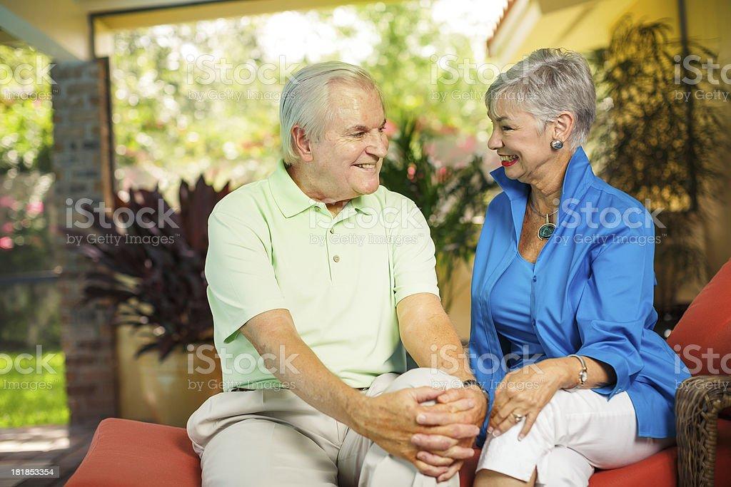 affectionate senior couple stock photo