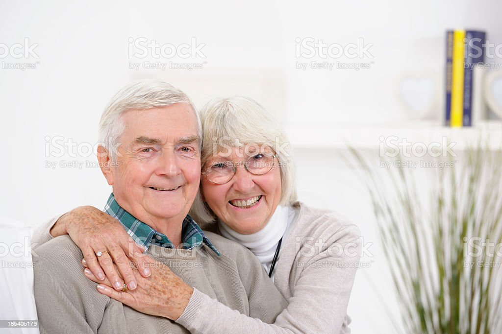 Affectionate Senior Couple Relaxing At Home royalty-free stock photo