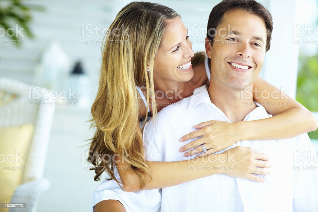 Affectionate woman embracing man royalty-free stock photo