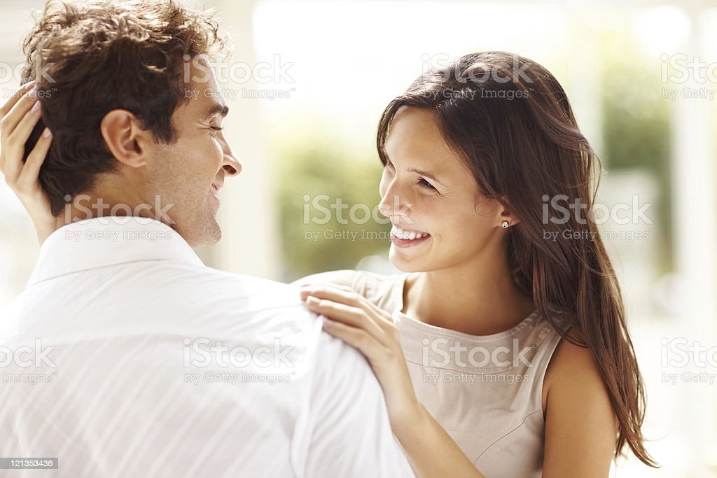 Affectionate young couple looking at each other royalty-free stock photo