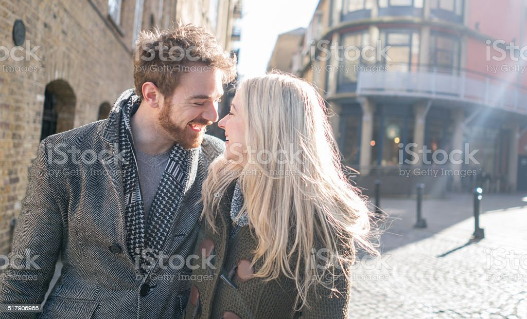 Affectionate young couple outdoors stock photo