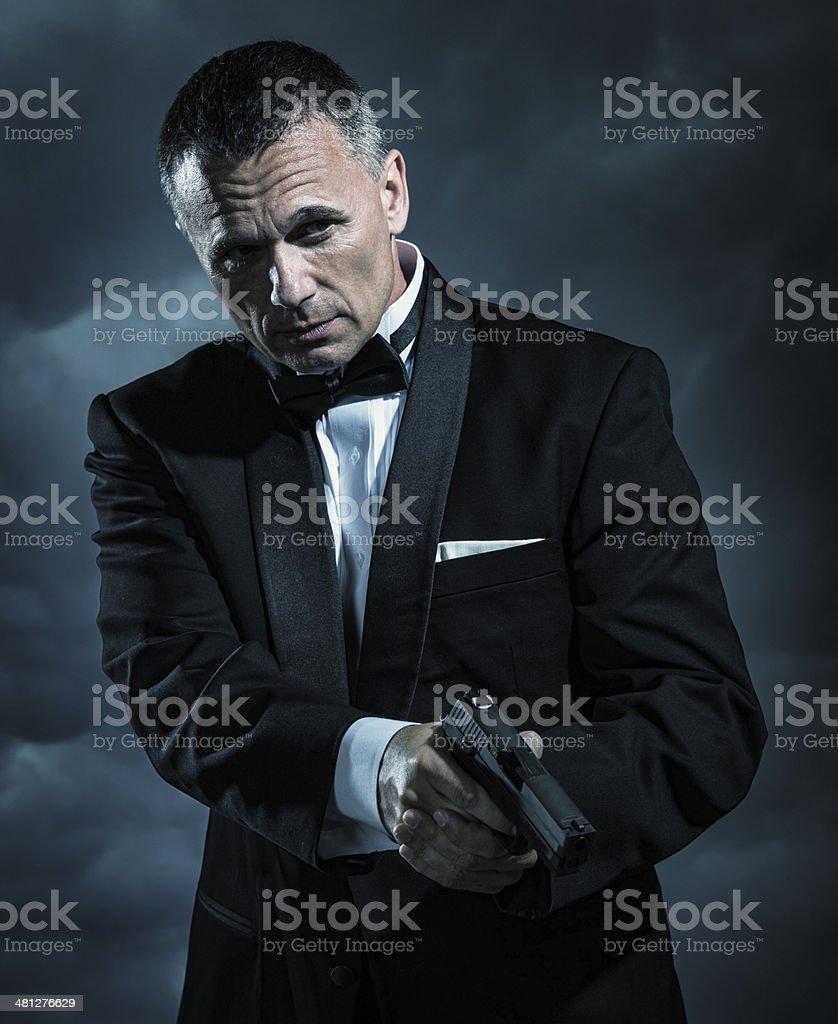 Affluent Bodyguard with Handgun stock photo