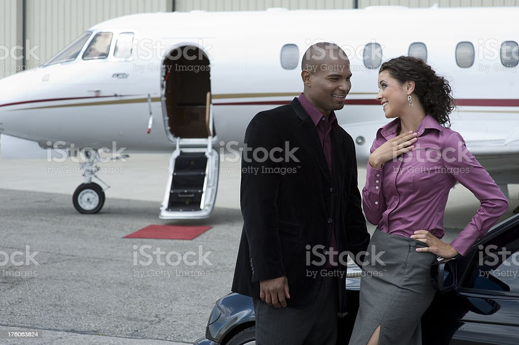 Affluent Travel - Ethnic couple enjoying life royalty-free stock photo