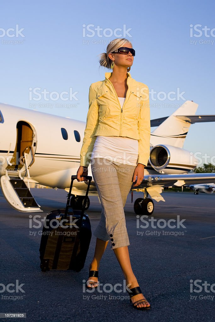 Affluent Travel-Beautiful Woman Arriving at Airport royalty-free stock photo