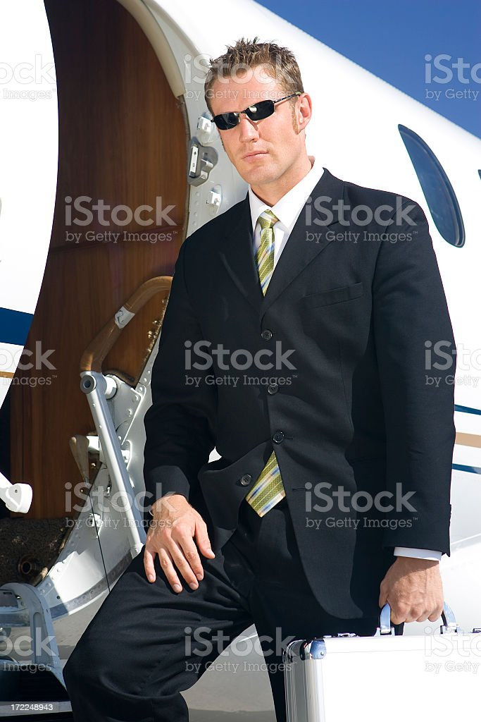 Affluent Travel-Businessman by Airplane Door royalty-free stock photo