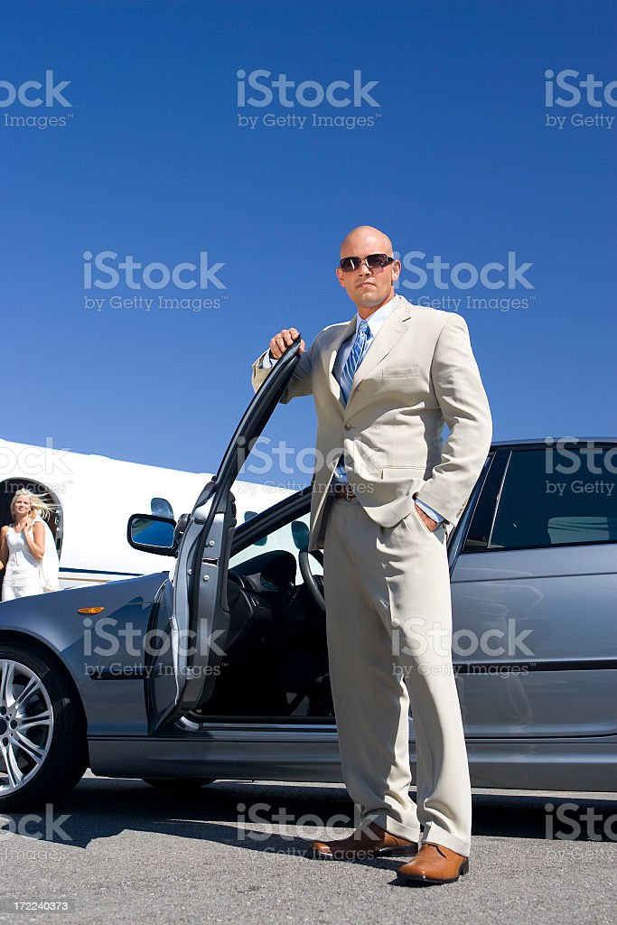 Affluent Travel-Businessman by Car at Airport royalty-free stock photo