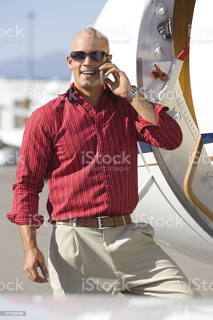 Affluent Travel-Casual Businessman on Phone by Private Jet royalty-free stock photo