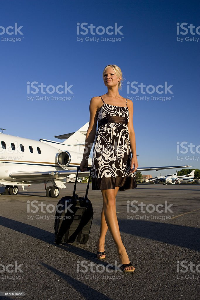 Affluent Travel-Sexy Woman Arriving at Airport royalty-free stock photo