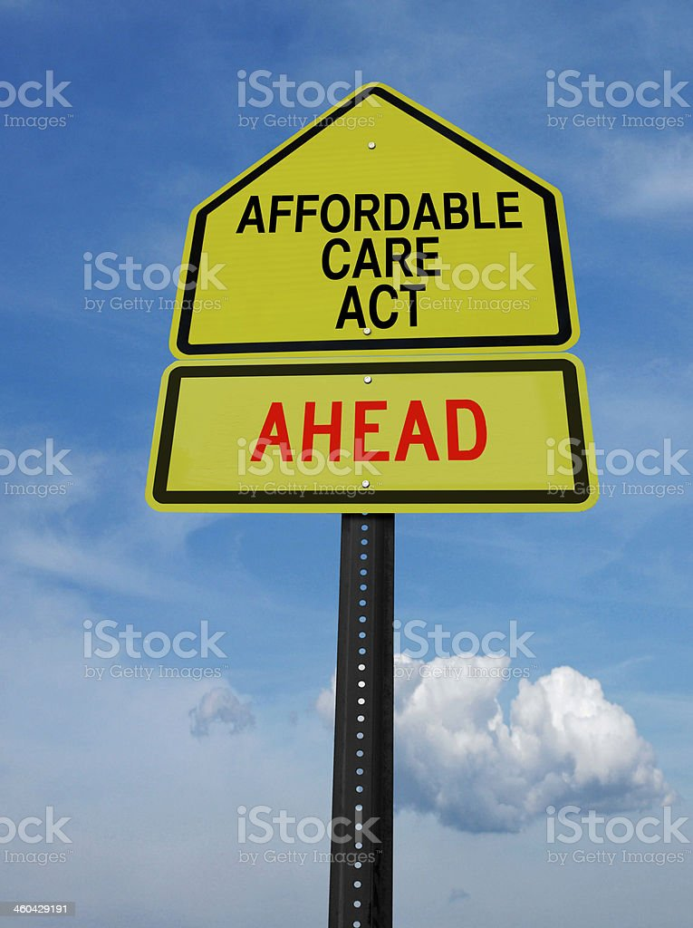 affordable care act ahead sign stock photo