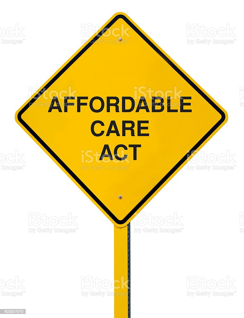 Affordable Care Act Road Sign Isolated Against a White Background stock photo