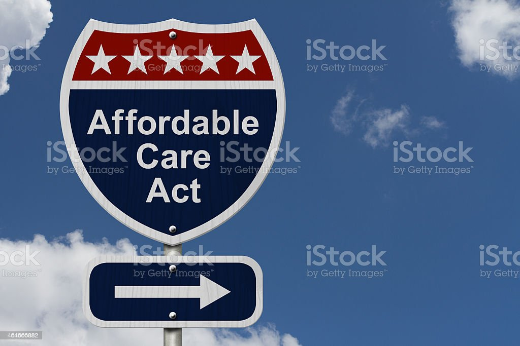 Affordable Care Act street sign in front of clear blue sky stock photo