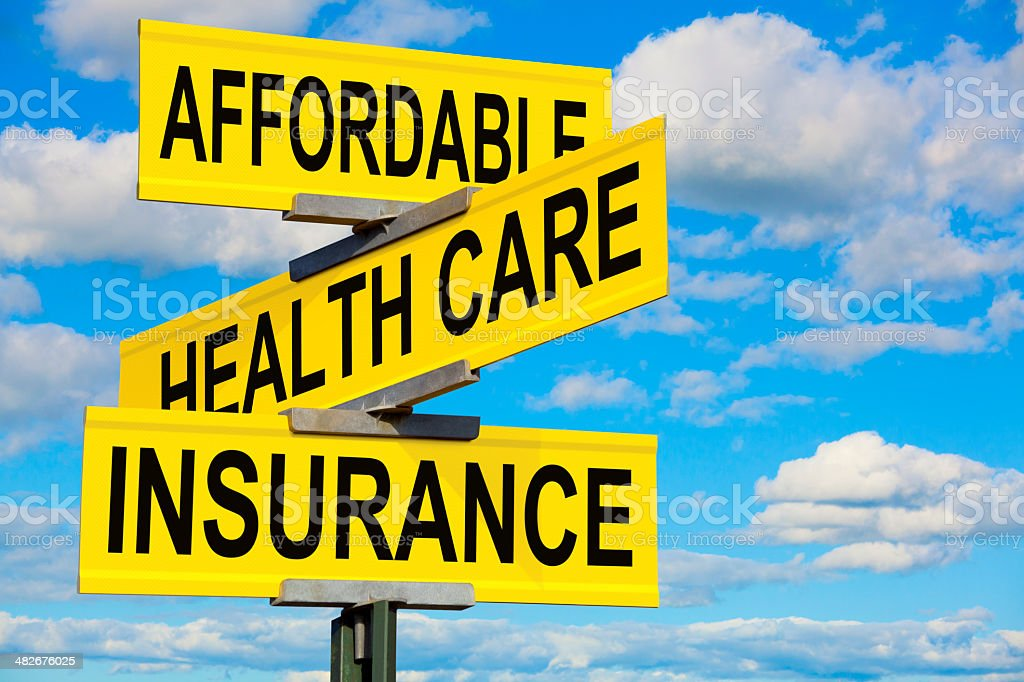 Affordable Health Care Insurance Street Sign royalty-free stock photo
