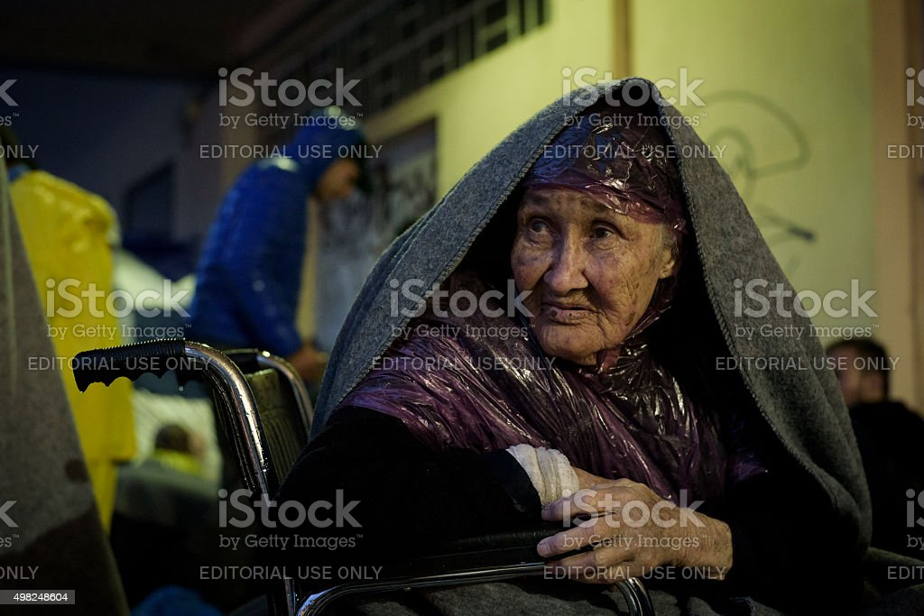 Afghan migrant in wheelchair on Lesbos, Greece stock photo