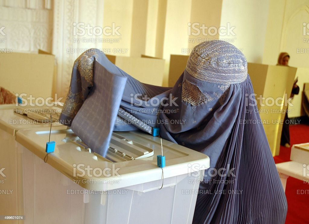 Afghan woman dressed in a burqa to electoral vote stock photo