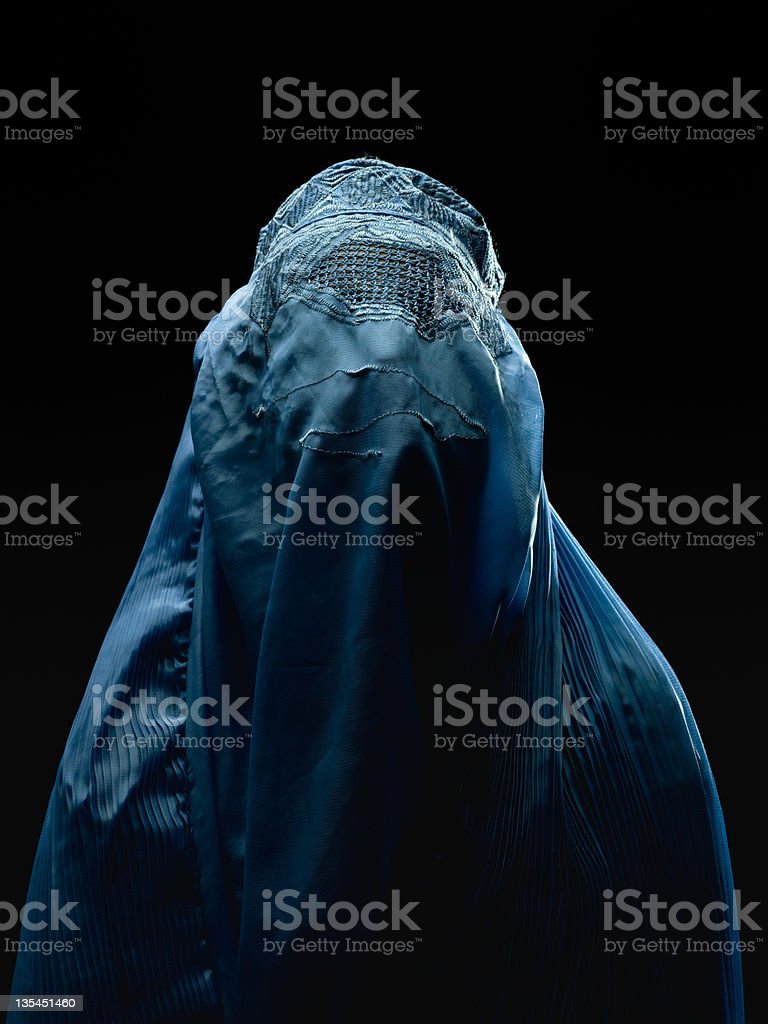 Afghan woman wearing her burkha stock photo
