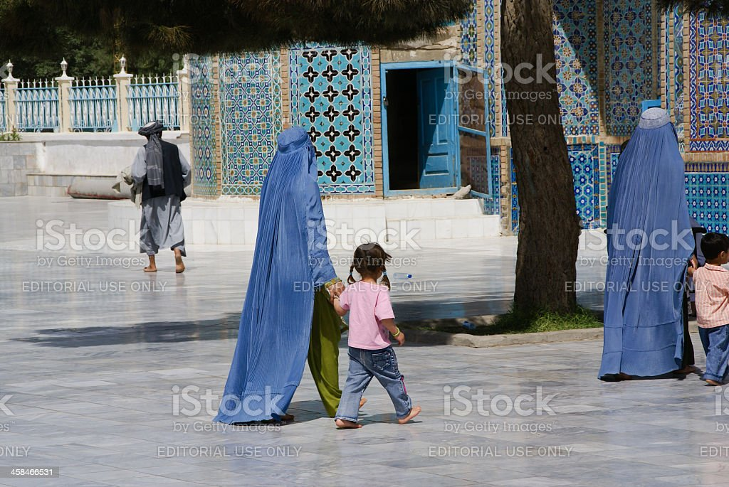 Afghan women walking with their children at the Blue Mosque. stock photo