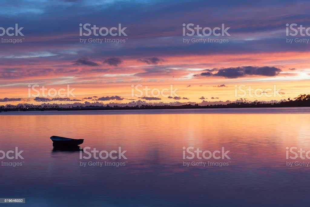 Afloat in reflected sky colors stock photo
