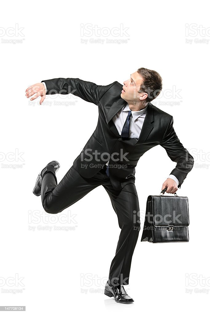 Afraid businessman running away stock photo