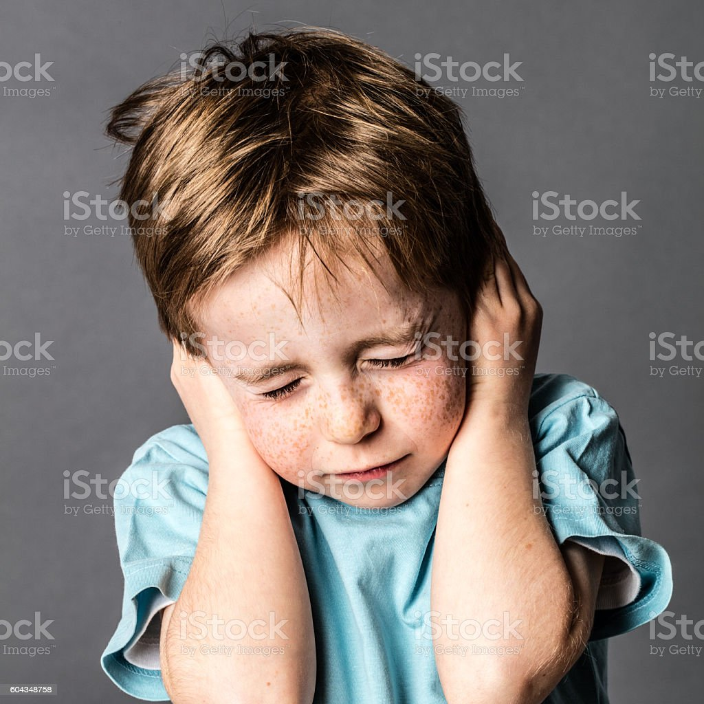 afraid little boy closing ears and eyes against domestic violence stock photo