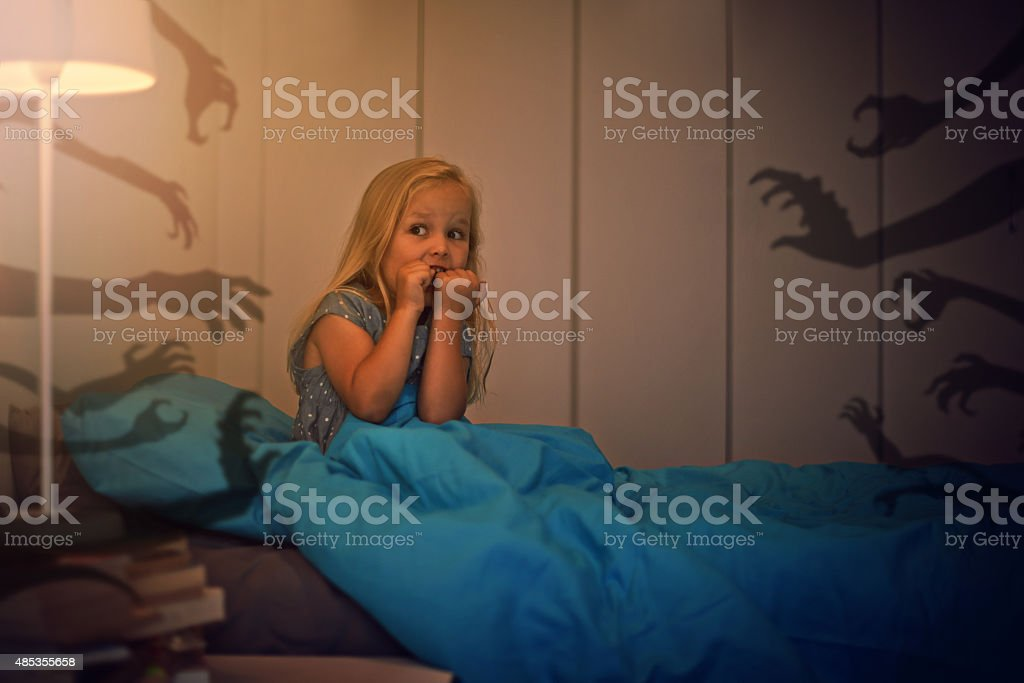Afraid of the monsters lurking in the shadows stock photo