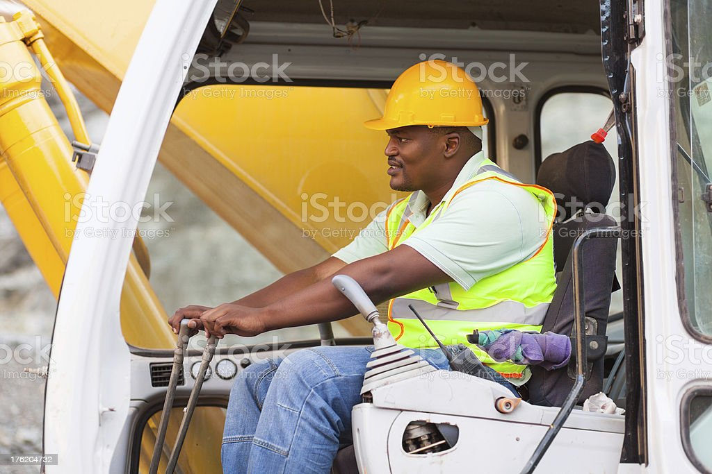 africa american man operates excavator royalty-free stock photo