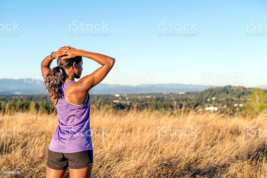 African American adult female with hands on her head stock photo