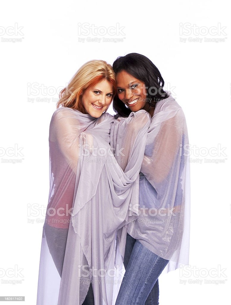 African American and Caucasian Young Women Wrapped in Sheer Fabric stock photo