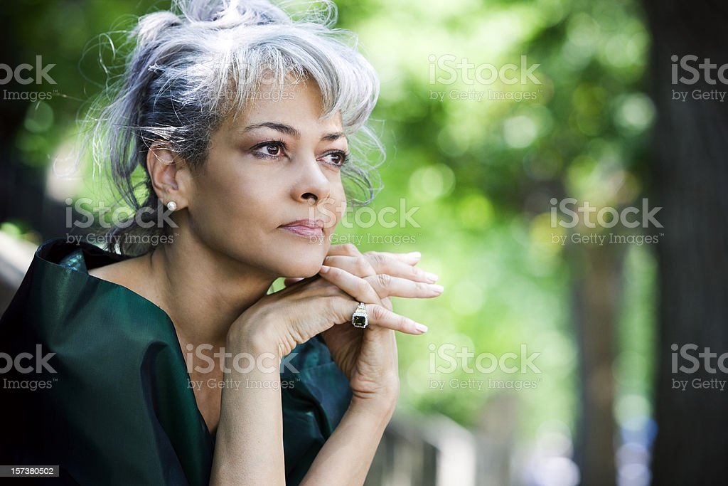African American Beautiful Senior Woman Sitting Outdoors, Copy Space stock photo