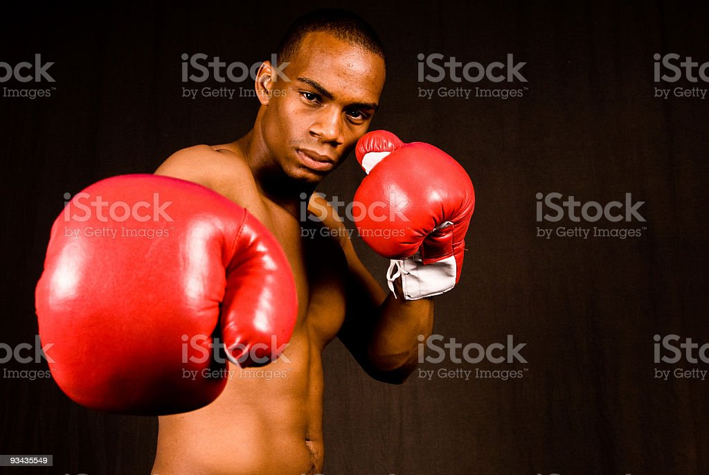 African American boxer wearing red boxing gloves royalty-free stock photo