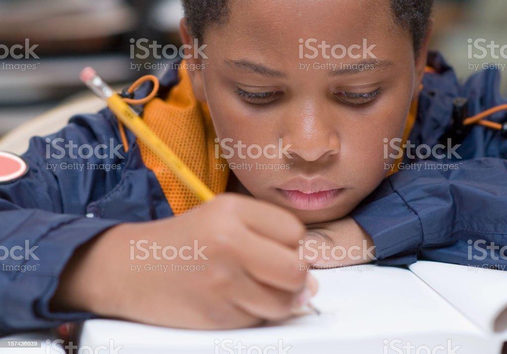 African American boy doing homework royalty-free stock photo