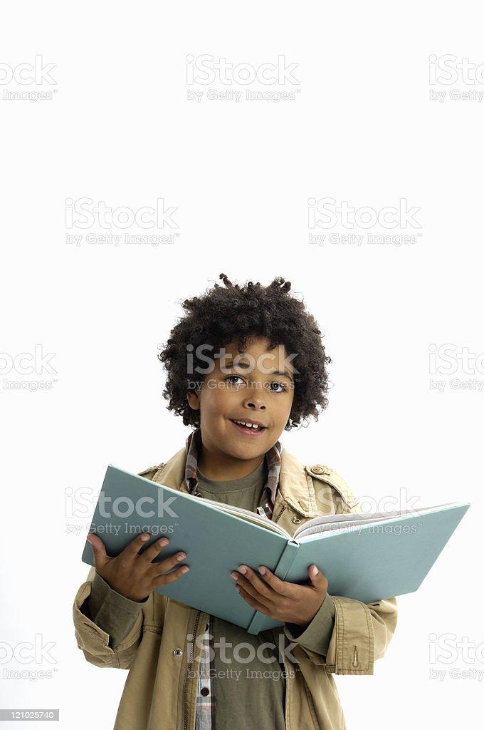 African American boy enjoying reading a book. stock photo