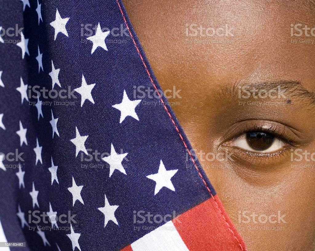 African American Boy Holding Flag royalty-free stock photo
