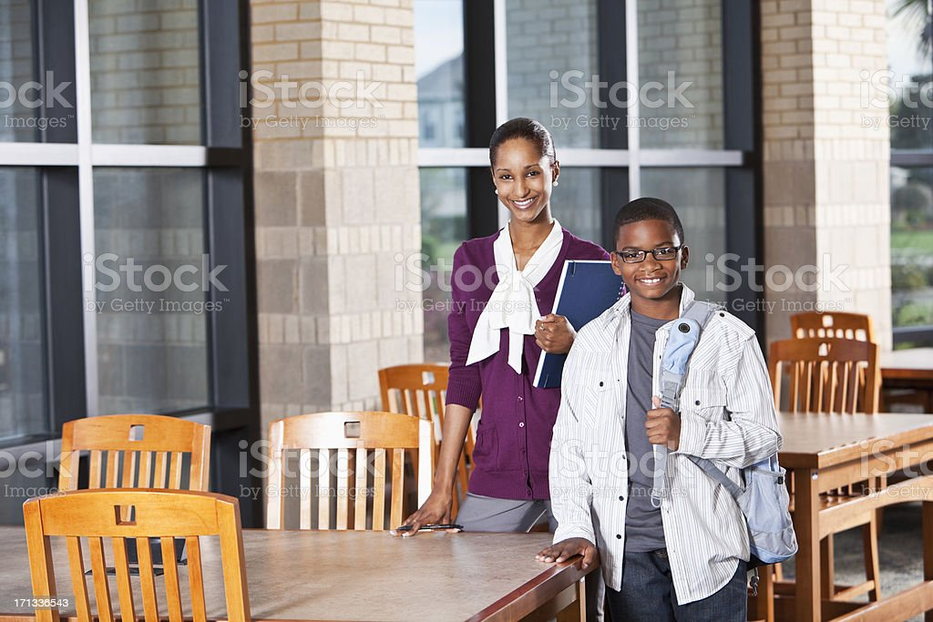 African American boy in school with teacher royalty-free stock photo