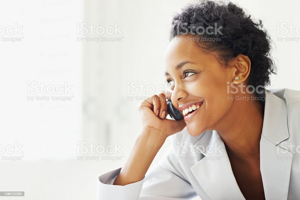 African American busines woman talking over cellphone royalty-free stock photo